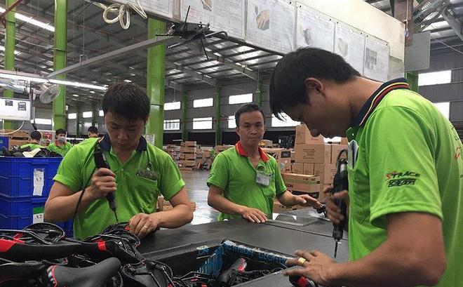 Việt Nam được đánh giá là điểm đến của các nhà máy gia công ngành may mặc, giày gia, điện tử. Ảnh: P.ĐIỀN