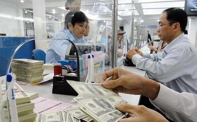 Những ngày gần đây, tỉ giá USD biến động khá mạnh. Ảnh: TL