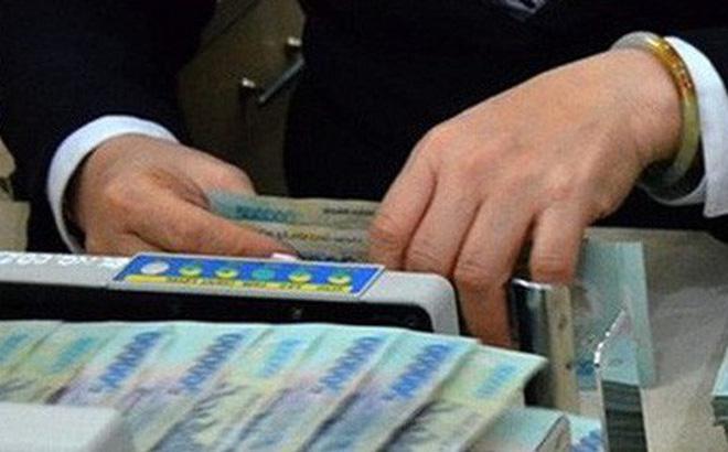 Từ nay đến cuối năm, lãi suất ngân hàng rất khó giảm. (Ảnh minh họa: KT)